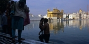 Morning bath of a sikh father and his son at the Golden Temple, Amritsar, India, 2010