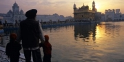 Sikh grandfather and his grandchildren at the Golden Temple, Amritsar, India, 2010